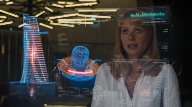 Pepper Potts views the Stark Tower and new Arc Reactor schematics.