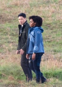 Monica Rambeau (Teyonah Parris) and Jimmy Woo (Randall Park) on the set of WandaVision.